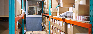 """Warehouse shelves with cardboard boxes. """