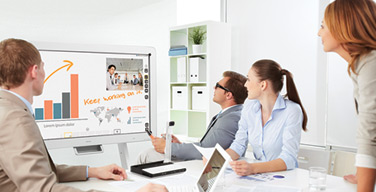 Photo of people using an interactive whiteboard