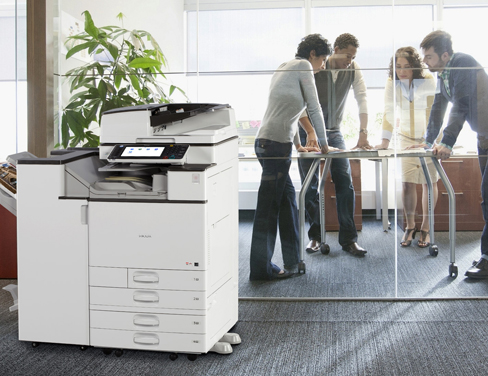 Office employees using printer.
