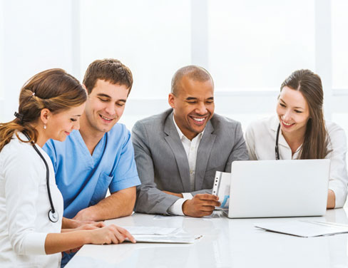 Health professionals in meeting room