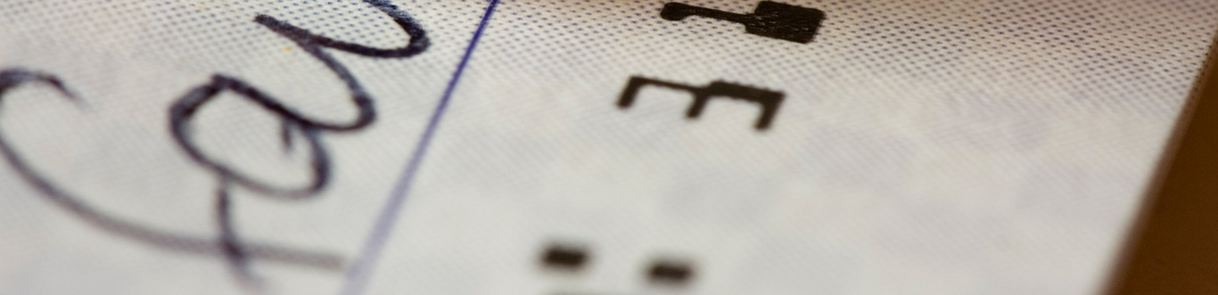 Closeup photo of a checkbook check.